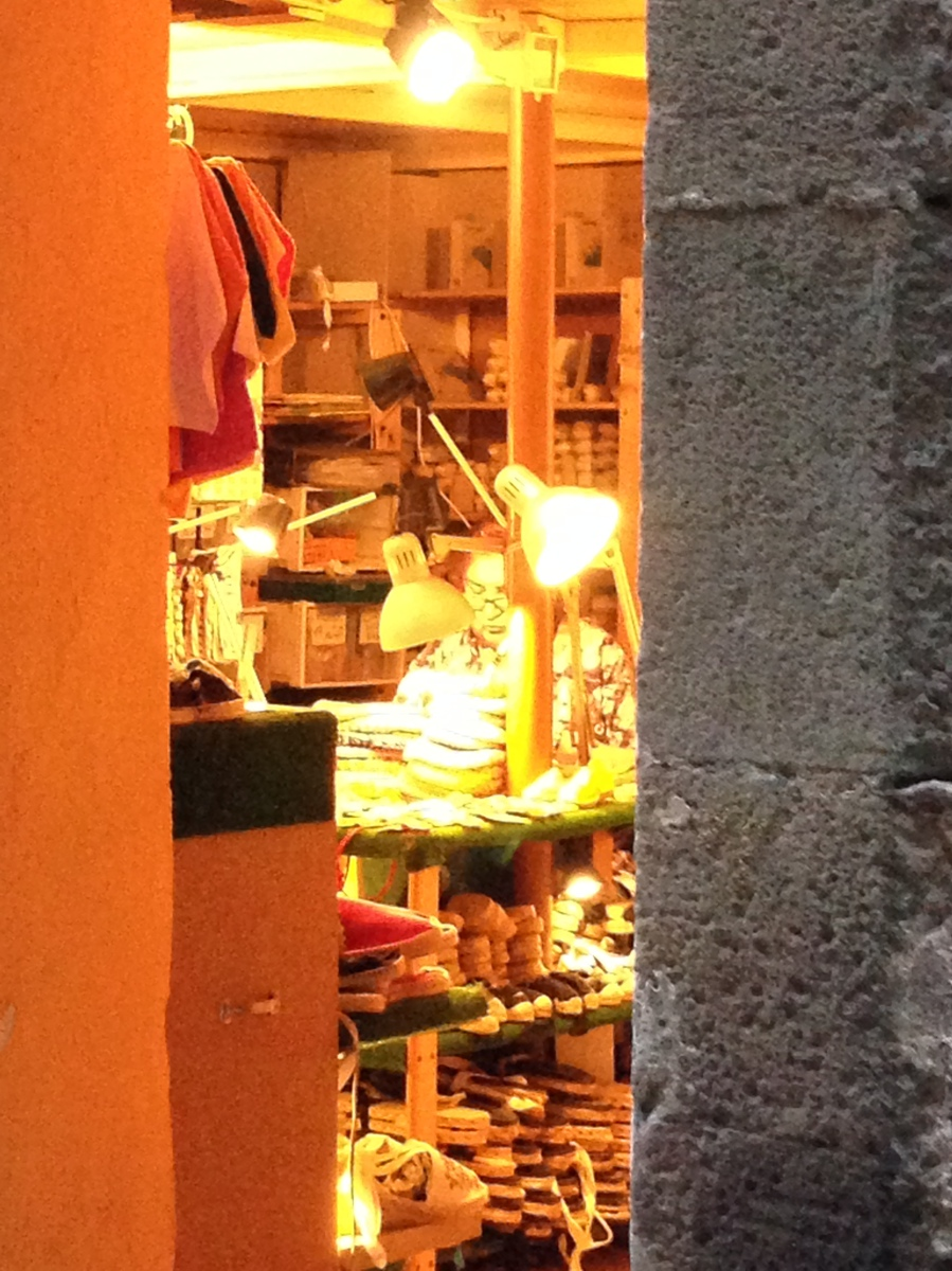 Spotted late Sunday evening, hard at work in the back of the shop.  Still seems to be a strong sense of tradition in Barcelona with many proprietors working their craft on the premises